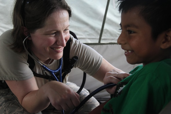 U.S. Air Force Capt. Katie Coble, 96th Medical Group, checks a patient's heart beat at a medical readiness event in Dangriga, Belize, May 22, 2017. This is the third and final medical event for Beyond the Horizon 2017, a U.S. Southern Command-sponsored, Army South-led exercise designed to provide humanitarian and engineering services to communities in need, demonstrating U.S. support for Belize. (U.S. Army photo by Spc. Kelson Brooks)