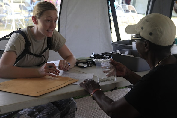 U.S. Air Force Capt. Glynnis Knobloch, 96th Medical Group, prescribes medicine to a patient at a medical readiness event in Dangriga, Belize, May 22, 2017. This is the third and final medical event scheduled for Beyond the Horizon 2017, a U.S. Southern Command-sponsored, Army South-led exercise designed to provide humanitarian and engineering services to communities in need, demonstrating U.S. support for Belize. (U.S. Army photo by Spc. Kelson Brooks)