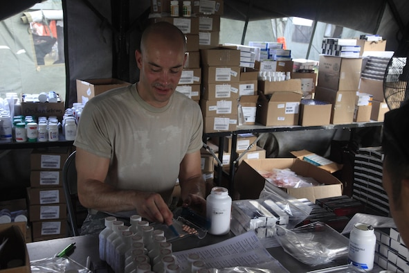 U.S. Air Force Tech Sgt. Bryan Kopco, 96th Medical Group, fills prescription bags at a medical readiness event during in Dangriga, Belize, May 22, 2017. This is the third and final medical event scheduled for Beyond the Horizon 2017, a U.S. Southern Command-sponsored, Army South-led exercise designed to provide humanitarian and engineering services to communities in need, demonstrating U.S. support for Belize. (U.S. Army photo by Spc. Kelson Brooks)