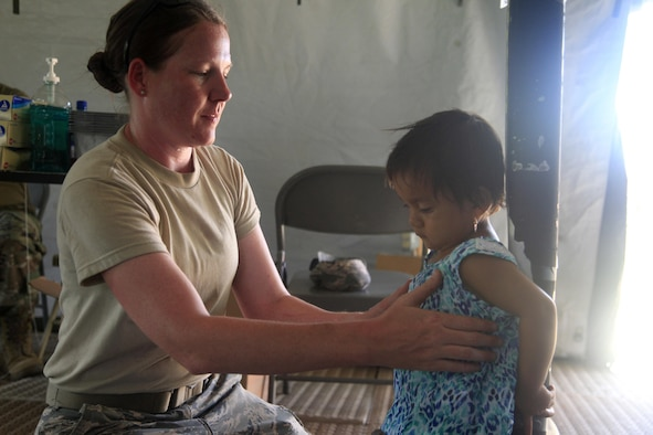 U.S. Air Force Master Sgt. Laura Winn, 96th Medical Group, measures a patient's height, at a medical readiness event in Dangriga, Belize, May 22, 2017. This is the third medical and final event scheduled for Beyond the Horizon 2017, a U.S. Southern Command-sponsored, Army South-led exercise designed to provide humanitarian and engineering services to communities in need, demonstrating U.S. support for Belize. (U.S. Army photo by Spc. Kelson Brooks)