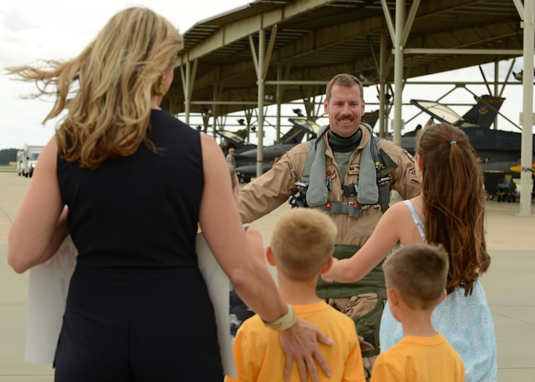 Lt. Col. Craig Andrle, 79th Fighter Squadron (FS) commander, prepares to embrace his family on the Shaw Air Force Base, S.C., flightline after returning from a deployment May 4, 2017. For the first time since 9/11, the 79th served as the only fighter squadron in theater, and the number of fighter jets available to them dropped from 18 to 12 – a limitation that didn't stop them from dropping almost double the amount of weapons as previous units. (U.S. Air Force photo by Airman 1st Class Kathryn R.C. Reaves)