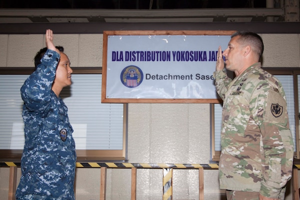 Army Brig. Gen. John S. Laskodi, DLA Distribution commanding general, hosted a reenlistment ceremony for material management noncommissioned officer Navy Logistics Specialist 1st Class Juliber C. Fernandez on May 16 at DLA Distribution Sasebo, Japan.