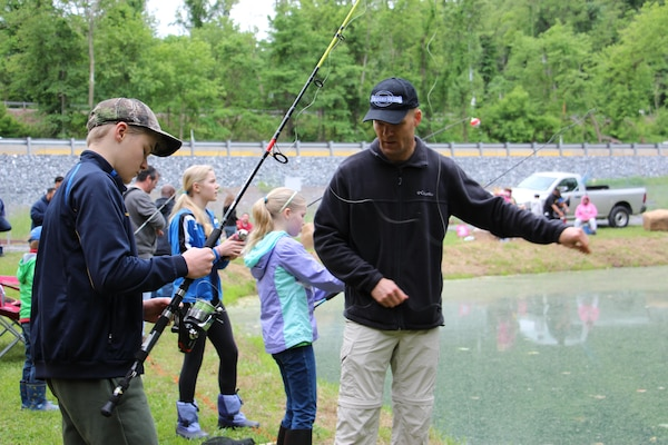 DLA Distribution Susquehanna commander Army Col. Brad J. Eungard participates in the annual Children's Trout Derby held on May 20 at the Children's Trout Pond located on Defense Distribution Center Susquehanna.
