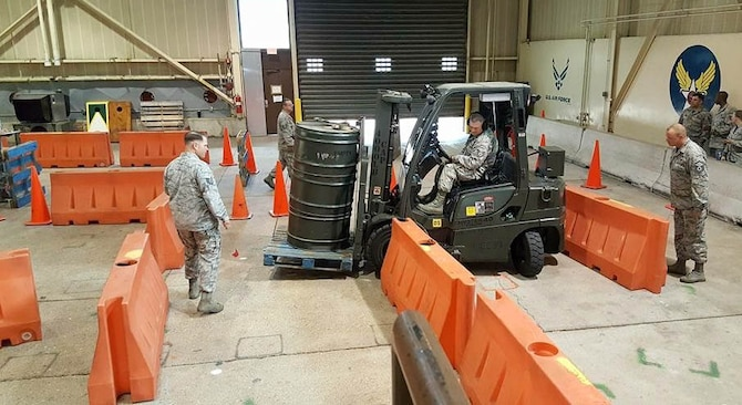 A U.S. Airman maneuvers a 4k forklift through an obstacle course during the Midwest Ground Transportation Rodeo at Fort Leonard Wood, Mo., May 21, 2017.