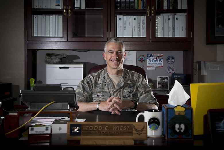 PETERSON AIR FORCE BASE, Colo. – Col. Todd Wiest, Strategic Warning and Surveillance System Division senior material leader, manages a team of Airmen accountable for the procurement and sustainment of 21st Space Wing assets at Peterson Air Force Base, Colo., May 10, 2017. Wiest's team supports the 21st Operations Group operators and systems who provide missile warning, and support missile defense and space situational awareness 24/7. (U.S. Air Force photo by Senior Airman Dennis Hoffman)