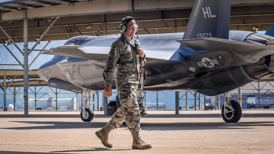 Airman 1st Class Michael Wilkins, a crew chief assigned to the 34th Aircraft Maintenance Unit, walks toward a sun shade after launching an F-35 Lightning II aircraft, number 5079, at Hill Air Force Base, Utah, May 22. In addition to the sortie being the 3,000th in an operational F-35 at Hill, it also turned out to be Wilkens's first solo launch. (U.S. Air Force/Paul Holcomb)