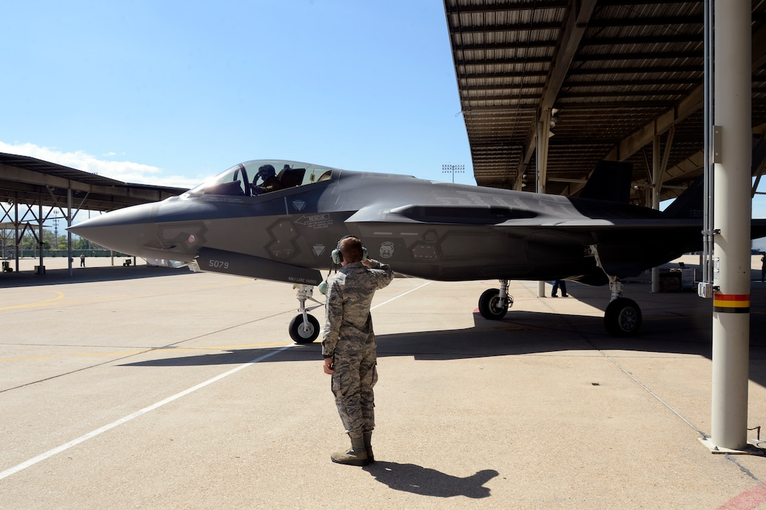 Airman 1st Class Michael Wilkins, a crew chief assigned to the 34th Aircraft Maintenance Unit, launches an F-35 Lightning II aircraft, number 5079, at Hill Air Force Base, Utah, May 22. In addition to the sortie being the 3,000th in an operational F-35 at Hill, it also turned out to be Wilkens's first solo launch. (U.S. Air Force/Todd Cromar)