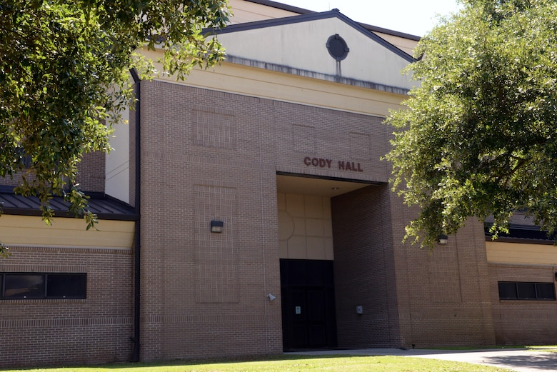 Cody Hall is the largest academic building on Keesler AFB and is located in Bldg. 4202. It marks the start of the place where all ground-based command and control (C2) training in eight different Air Force Specialty Codes begins. More than 7,000 Airman from the 334th Training Squadron train at Cody Hall annually and provide critical C2 capabilities to the Air Force mission; which is to lead, motivate, and develop C2 and Battlefield Airmen to support Joint and Coalition Operations worldwide. (U.S. Air Force photo by 2nd Lt. Teddy Barbosa)