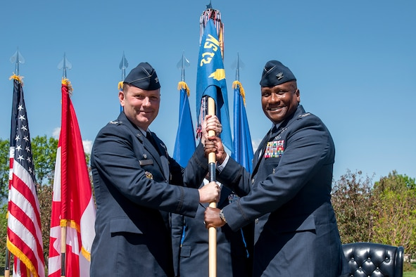 PETERSON AIR FORCE BASE, Colo. – Col. Doug Schiess, 21st Space Wing commander, passes the 21st Operation Group guidon to Col. Devin Pepper, 21st Operations Group commander, during the group's change of command ceremony at Peterson Air Force Base, Colo., May 30, 2017. Pepper assumed command of 21st OG, Air Force Space Command's largest, most weapon-system diverse and geographically separated operations group. The group provides real-time missile warning, attack assessment and space control to the President, Secretary of Defense, Joint Chief of Staff, combatant commands and foreign allies. (U.S. Air Force photo by Senior Airman Dennis Hoffman)