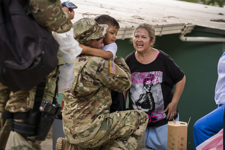 U.S. Army Lt. Col. Rhonda Dyer, Joint Task Force - Bravo, gets a hug from a local Honduran child while out on a Community Health Nurse mission in Comayagua, Honduras, May 10, 2017. The CHM is a weekly partnership with the staff at Jose Ochoa Public Health Clinic, administering vaccines, Vitamins, deworming medication and other medical supplies to over 180 Hondurans around the Comayagua area on May 10, 2017.  (U.S. Air National Guard photo by Master Sgt. Scott Thompson/released)