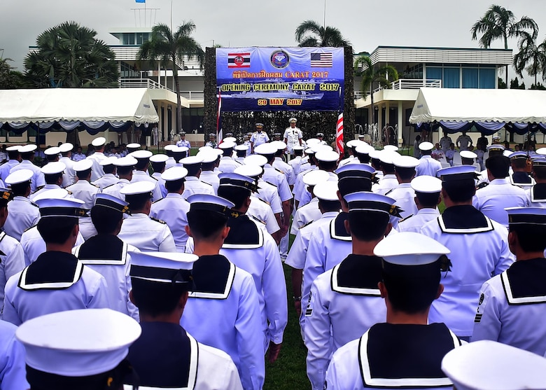 Service members from the United States Navy and Royal Thai Navy stand in formation at the opening ceremony for Cooperation Afloat Readiness and Training Thailand 2017 at Sattahip Naval Base, Thailand, May 29, 2017.  Cooperation Afloat Readiness and Training (CARAT) is a series of PACOM sponsored, U.S. Pacific Fleet led bilateral exercises held annually in South and Southeast Asia to strengthen relationships and enhance force readiness. CARAT exercise events cover a broad range of naval skill areas and disciplines including surface, undersea, air and amphibious warfare; maritime security operations; riverine, jungle and explosive ordnance disposal operations; combat construction; diving and salvage; search and rescue; maritime patrol and reconnaissance aviation; maritime domain awareness; military law, public affairs and military medicine; and humanitarian assistance, disaster response.