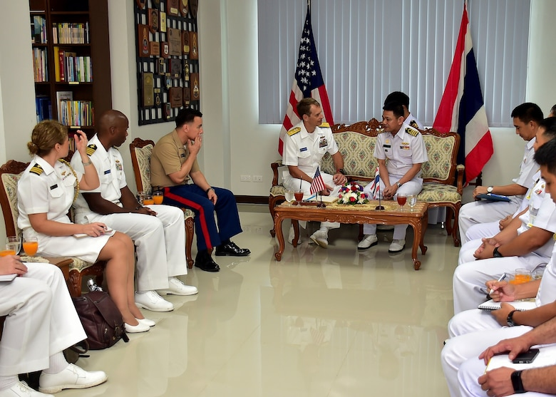 Rear Adm. Don Gabrielson, Commander, Task Force 73, makes an office call with Rear Adm. Chaiyanun Nuntawit, Commander, Frigate Squadron II, on Sattahip Naval Base, Thailand, May 29, 2017. Cooperation Afloat Readiness and Training (CARAT) is a series of PACOM sponsored, U.S. Pacific Fleet led bilateral exercises held annually in South and Southeast Asia to strengthen relationships and enhance force readiness. CARAT exercise events cover a broad range of naval skill areas and disciplines including surface, undersea, air and amphibious warfare; maritime security operations; riverine, jungle and explosive ordnance disposal operations; combat construction; diving and salvage; search and rescue; maritime patrol and reconnaissance aviation; maritime domain awareness; military law, public affairs and military medicine; and humanitarian assistance, disaster response.