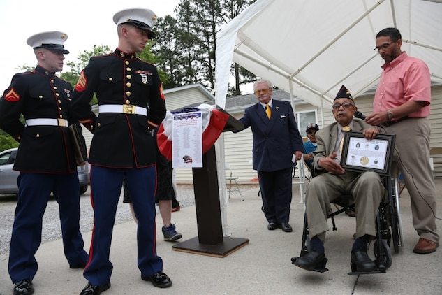 "Two Marines with the 9th Marine Corps District, based out of Naval Station Great Lakes, Illinois, were on hand to honor four Montford Point Marines, May 27, at the Colp Area Veterans Celebration, Dedication and Remembrance Ceremony, in Colp, Illinois. Nearly 20,000 African-Americans joined the Marine Corps in 1942, after President Franklin D. Roosevelt issued a ""presidential directive giving African Americans an opportunity to be recruited in the Marine Corps,"" according to the Montford Point Marines Association website. They didn't receive recruit training at San Diego or Parris Island, however, but Camp Montford Point, N.C., a segregated training site for African American Marine recruits. For the next seven years, the camp remained opened until it became desegregated. The four Marines are Sol Griffin, Jr.; James L. Kirby, Early Taylor, Jr. and Archibald Mosley. These Marines, among many other Montford Point Marines across the country, were awarded the Congressional Gold Medal, the highest award that can be given to a civilian by Congress, in 2012. (U.S. Marine Corps photo by Gunnery Sgt. Bryan A. Peterson)"