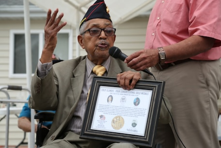 "Archibald Mosley gives a speech after receiving a Congressional Gold Medal memento for Montford Point Marines, May 27, at the Colp Area Veterans Celebration, Dedication and Remembrance Ceremony, in Colp, Illinois. Nearly 20,000 African-Americans joined the Marine Corps in 1942, after President Franklin D. Roosevelt issued a ""presidential directive giving African Americans an opportunity to be recruited in the Marine Corps,"" according to the Montford Point Marines Association website. They didn't receive recruit training at San Diego or Parris Island, however, but Camp Montford Point, N.C., a segregated training site for African American Marine recruits. For the next seven years, the camp remained opened until it became desegregated. The four Marines are Sol Griffin, Jr.; James L. Kirby, Early Taylor, Jr. and Archibald Mosley. These Marines, among many other Montford Point Marines across the country, were awarded the Congressional Gold Medal, the highest award that can be given to a civilian by Congress, in 2012. Mosley is one of four Montford Point Marines from Colp. (U.S. Marine Corps photo by Gunnery Sgt. Bryan A. Peterson)"