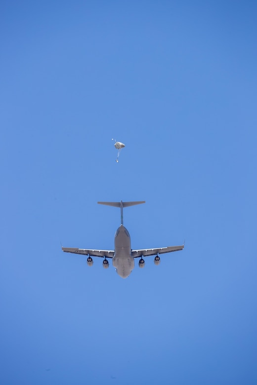 A parachute test dummy exits a C-17 Globemaster III and begins it's descent to earth under guidance of a Remotely Piloted Parachute System. This was the maiden flight of the RPPS. (U.S. Air Force photo by Christian Turner)