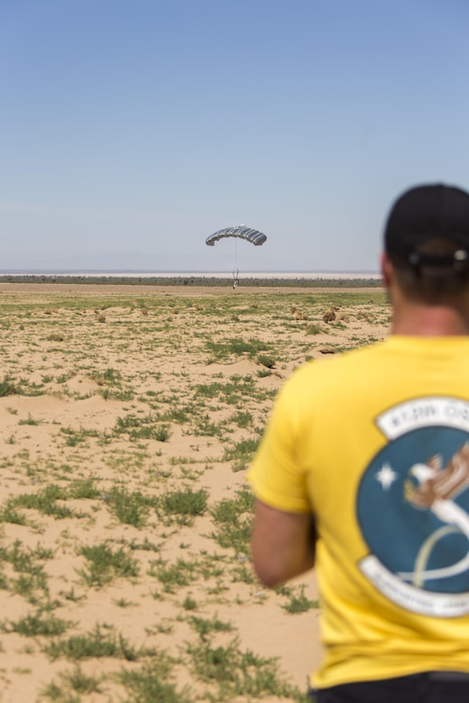 Trever Bush, 412th OSS Parachute Test Team, guides a test dummy in using the Remotely Piloted Parachute System he designed and built. (U.S. Air Force photo by Christian Turner)