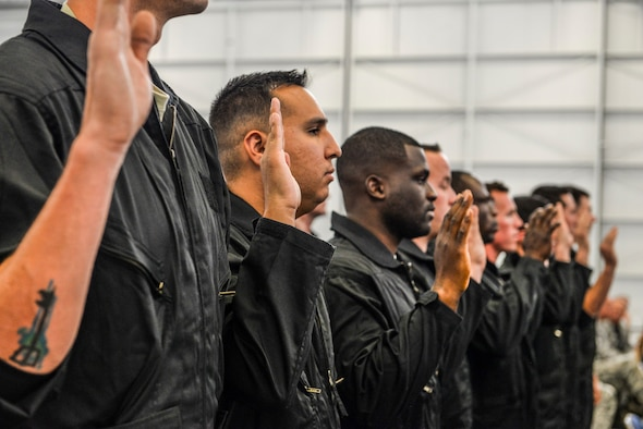Dedicated crew chiefs assigned to the 57th Wing recite their professional oath during a dedication ceremony at Nellis Air Force Base, Nev., May 19, 2017. Each DCC is assigned an aircraft that they are responsible for maintaining. A dedicated crew chief's technical knowledge is second-to-none and is heavily relied upon to ensure their aircraft's mission success. (U.S. Air Force photo by Airman 1st Class Andrew D. Sarver/Released)