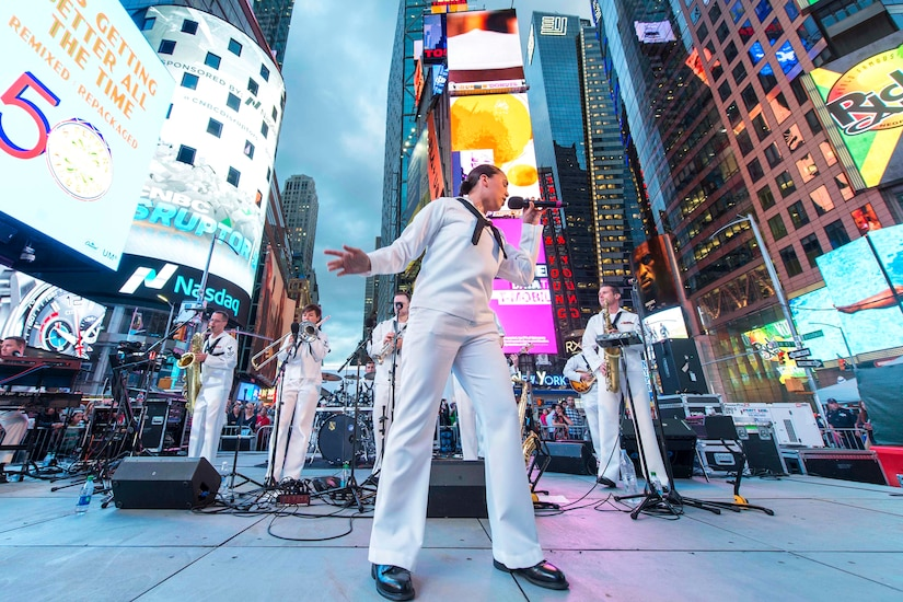Navy Seaman Crissy Villalva sings during a free concert in Times Square as part of Fleet Week New York in New York City, May 26, 2017. Villalva is a musician assigned to the Navy Band Northeast's Rhode Island Sound. Navy photo by Petty Officer 2nd Class Charles Oki