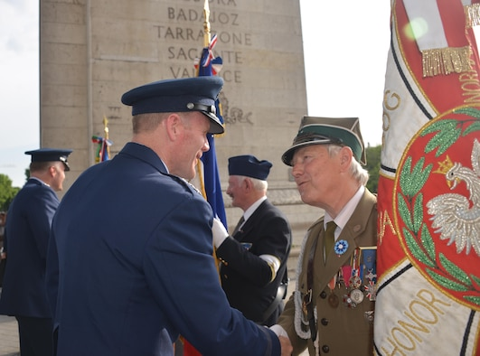 U.S. Air Force Gen Tod D. Wolters, U.S. Air Forces in Europe - Air Forces Africa commander, greets a French flagbearer during a Memorial Day ceremony at the Arc de Triomphe, Paris, France, May 28, 2017. This Memorial Day is especially significant because 2017 marks the centennial of United States' entry into the First World War. (U.S. Air Force photo by Capt. Ben Sowers/Released)