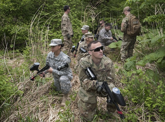 U.S. Soldiers with the Delta Detachment, 1st Space Company, Joint Tactic Army Ground Station, halt during a tactical exercise at Misawa Air Base, Japan, May 24, 2017. Members worked in two separate teams, alpha and bravo. They were tasked with an objective to secure an area while under fire as well as maintaining communication among each other. (U.S. Air Force photo by Airman 1st Class Sadie Colbert)