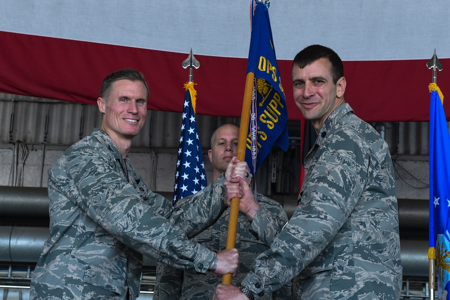 U.S. Air Force Col. Michael Thompson, 52nd Operations Group commander, left, gives the ceremonial guidon to U.S. Air Force Lt. Col. Joshua Kubacz, incoming 52nd Operations Support Squadron commander, during the 52nd OSS change of command ceremony on Spangdahlem Air Base, Germany, May 19, 2017. (U.S. Air Force photo by Senior Airman Dawn M. Weber)