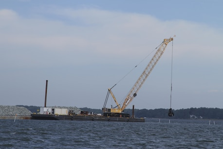 MATHEWS COUNTY, VA – Contractors use a crane to place granite along the bottom of the Piankatank River near Gwynn, Virginia.  The granite is being used to create 25 acres of new sanctuary reef habitat for oysters in the river.  (U.S. Army photo/Patrick Bloodgood)