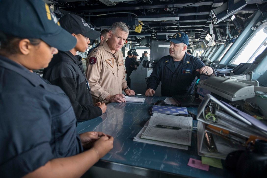 ARABIAN GULF (May 21, 2017) Rear Adm. Bruce Lindsey, commander of Naval Air Force Atlantic, meets with Sailors aboard the aircraft carrier USS George H.W. Bush (CVN 77). The ship is deployed in the U.S. 5th Fleet area of operations in support of maritime security operations designed to reassure allies and partners, and preserve the freedom of navigation and the free flow of commerce in the region. (U.S. Navy photo by Mass Communication Specialist 3rd Class Christopher Gaines/Released)