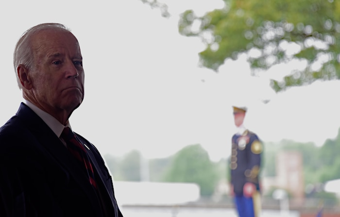 Former Vice President Joe Biden pays his respects to the fallen airman, soldiers, sailors and marines during the Memorial Day Ceremony at the Delaware Veteran's Memorial Park, New Castle, Del., 30 May 2017.(U.S. Air National Guard photo by SSgt. Andrew Horgan/released)
