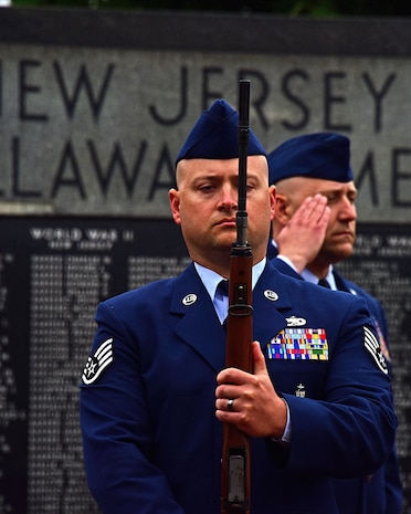 From left, Staff Sgt. Matthew Foulk and Master Sgt. Jeffrey Longfellow, 166th Airlift Wing Honor Guard render a salute during the Memorial Day Ceremony to honor the fallen at the Delaware Veteran's Memorial Park, New Castle, Del., 30 May 2017.(U.S. Air National Guard photo by SSgt. Andrew Horgan/released)