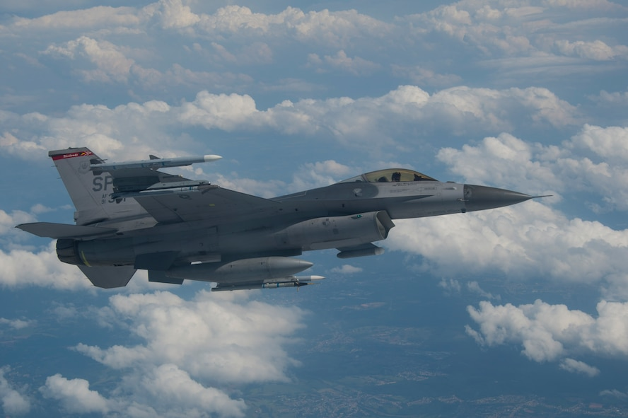 A U.S. Air Force F-16 Fighting Falcon flies over western Germany before receiving fuel during air-to-air refueling training from Spangdahlem Air Base, Germany, May 30, 2017. For more than a week the Iowa Air National Guard has been conducting air-to-air refueling training with F-16s from the 52nd Fighter Wing. (U.S. Air Force photo by Senior Airman Dawn M. Weber)