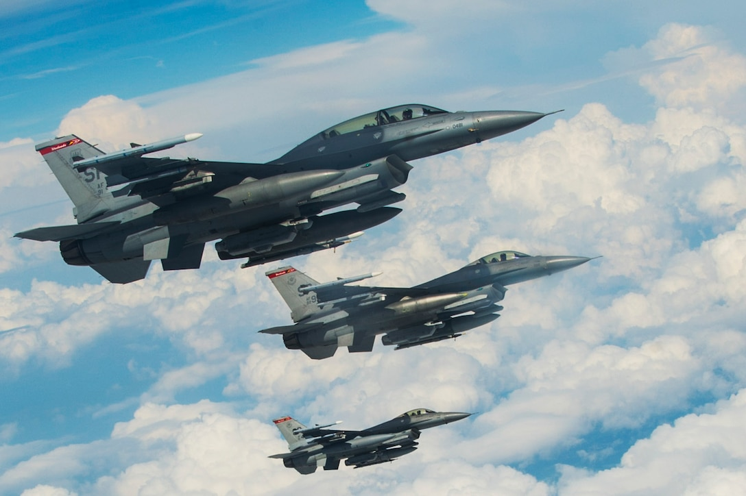 Three U.S. Air Force F-16 Fighting Falcons from the 480th Fighter Squadron fly beside an 185th Air Refueling Wing, Sioux City, Iowa KC-135 Stratotanker over Spangdahlem Air Base, Germany, May 30, 2017. For more than a week the Iowa Air National Guard has been conducting air-to-air refueling training with fighting falcons from the 52nd Fighter Wing. (U.S. Air Force photo by Senior Airman Dawn M. Weber)