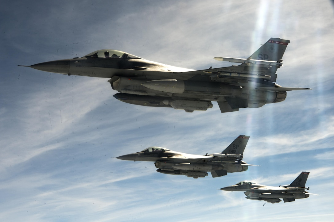 U.S. Air Force F-16 Fighting Falcons form up after air-to-air refueling over western Germany, May 30, 2017. During the flight, a KC-135 Stratotanker refueling aircraft passed approximately 60,000 pounds of fuel to 10 Spangdahlem Air Base Fighting Falcons. (U.S. Air Force photo by Airman 1st Class Preston Cherry)