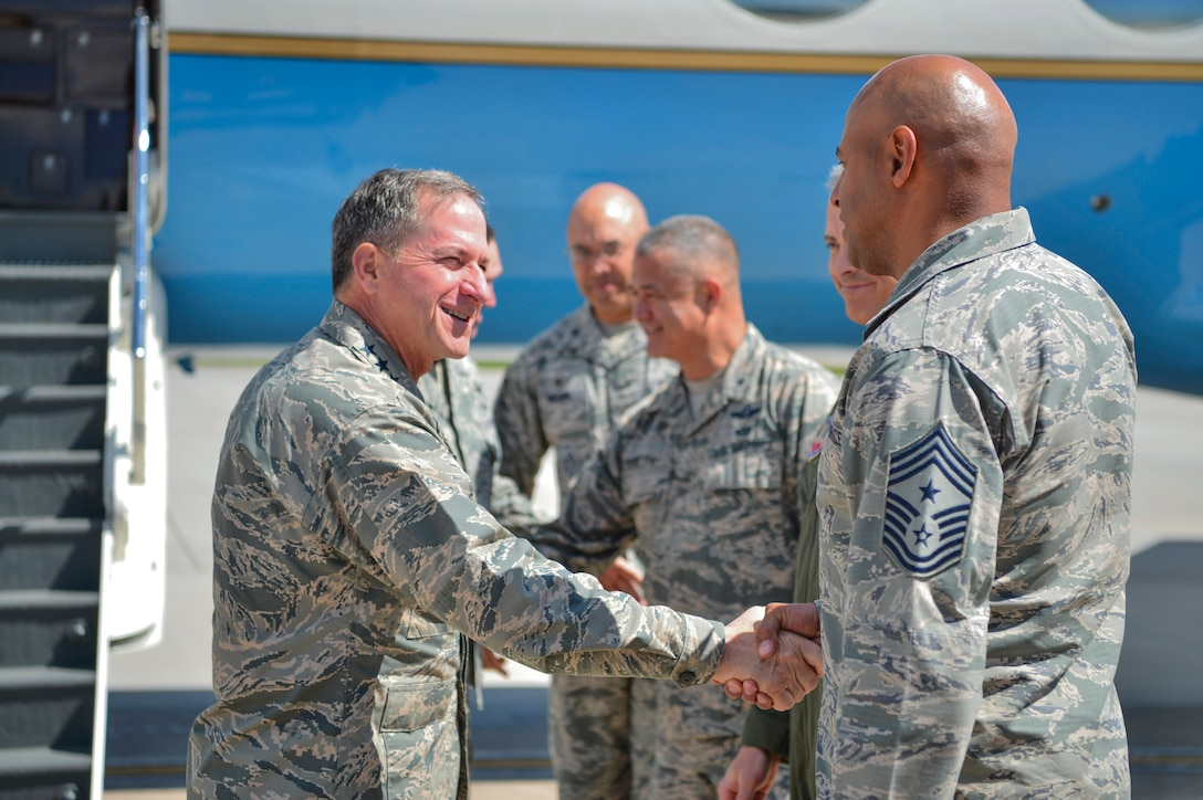 Chief Master Sgt. Rod Lindsey, 460th Space Wing command chief, greets Gen. David L. Goldfein, Chief of Staff of the U.S. Air Force, as he arrives May 25, 2017, on Buckley Air Force Base, Colo. During his visit, Goldfein walked through several static displays for a mission brief from the 140th Wing, met with space operators from the 460th Operations Group and toured the Aerospace Data Facility-Colorado. (U.S. Air Force photo by Airman 1st Class Holden S. Faul/ Released)