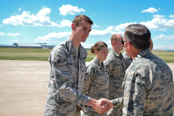 Gen. David L. Goldfein, Chief of Staff of the U.S. Air Force, gives Airman 1st Class Christopher Von Haasl, 140th Maintenance Squadron F-16 Fighting Falcon hydraulics technician, a coin in recognition of his hard work during his visit May 25, 2017, on Buckley Air Force Base, Colo. During his visit, Goldfein walked through several static displays for a mission brief from the 140th Wing, met with space operators from the 460th Operations Group and toured the Aerospace Data Facility-Colorado. (U.S. Air Force photo by Airman 1st Class Holden S. Faul/ Released)