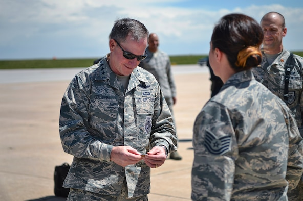 Gen. David L. Goldfein, Chief of Staff of the U.S. Air Force, receives a 140th Medical Group coin from Tech Sgt. Adrianna Jakupi, 140th MDG 140th readiness and training NCO, May 25, 2017, on Buckley Air Force Base, Colo. Jakupi briefed Goldfein on the mission capabilities of the National Guard Chemical, Biological, Radiological, Nuclear and High Yield Explosive Enhanced Response Force Package. (U.S. Air Force photo by Airman 1st Class Holden S. Faul/ Released)