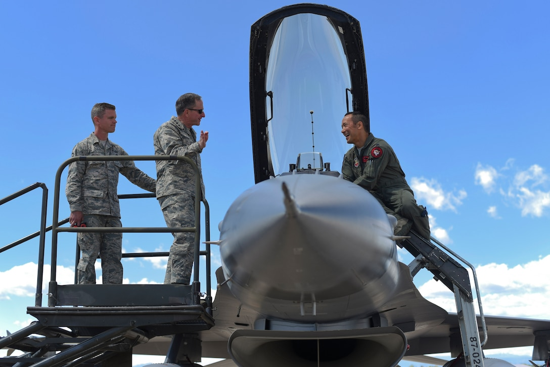 "Gen. David L. Goldfein, Chief of Staff of the U.S. Air Force, jokes with Lt. Col. Daniel ""Banzai"" Bunts, 120th Fighter Squadron F-16 Fighting Falcon pilot, during his visit May 25, 2017, on Buckley Air Force Base, Colo. Bonzai was recognized by Goldfein as the project officer from the first F-22 Raptor overseas deployment. (U.S. Air Force photo by Airman 1st Class Holden S. Faul/ Released)"