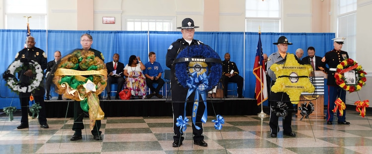Uniformed officers from Albany and Dougherty County Police Departments, Dougherty County Sheriff's Department as well as Marine Corps Logistics Base Albany's Marine Corps Police Department participate in the city's Law Enforcement Memorial Week Ceremony, recently. Albany State University's L. Orene Hall was the site for the event, which is held annually to commemorate the sacrifices of police officers who died in the line of duty.