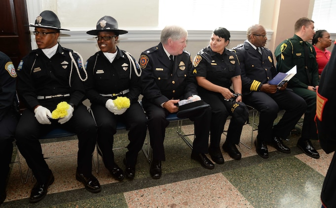 Marine Corps Logistics Base Albany's Marine Corps Police Department law enforcement personnel join uniformed officers from Albany and Dougherty County Police Departments, Dougherty County Sheriff's Department to participate in the city's Law Enforcement Memorial Week Ceremony, recently. Albany State University's L. Orene Hall was the site for the event, which is held annually to commemorate the sacrifices of police officers who died in the line of duty.