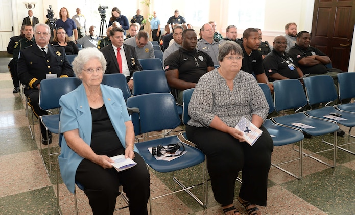 Family members of fallen police officers join uniformed law enforcement personnel from Albany and Dougherty County Police Departments, Dougherty County Sheriff's Department as well as Marine Corps Logistics Base Albany's Marine Corps Police Department to commemorate the sacrifices of officers who died in the line of duty. The ceremony, which was held at Albany State University's L. Orene Hall, recently, is an annual observance for the city's Law Enforcement Memorial Week.