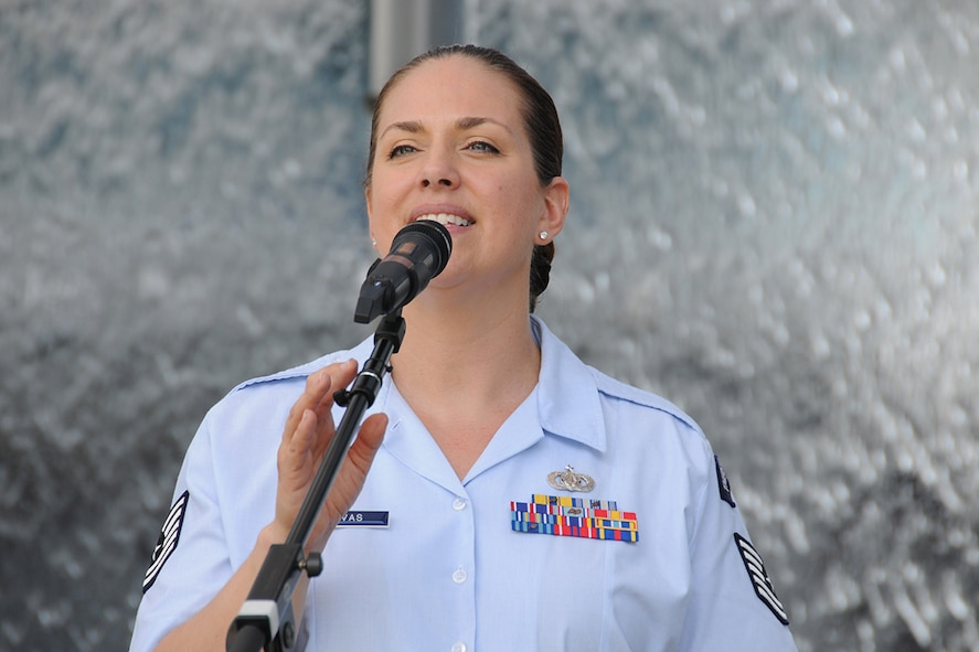 "Tech. Sgt. Julia Cuevas, U.S. Air Force Band's Celtic Aire founder and vocalist performs during a pre-game concert at SunTrust Park in Atlanta, Georgia May 20, 2017. As part of the Atlanta Braves' Military Appreciation Day celebration, the band took the crowd on a folk and pop musical journey, opening with Paul Simon's ""Cecelia"" and encoring with a medley of the armed forces' service songs. (U.S. Air Force photo/Airman 1st Class Justin Clayvon)"