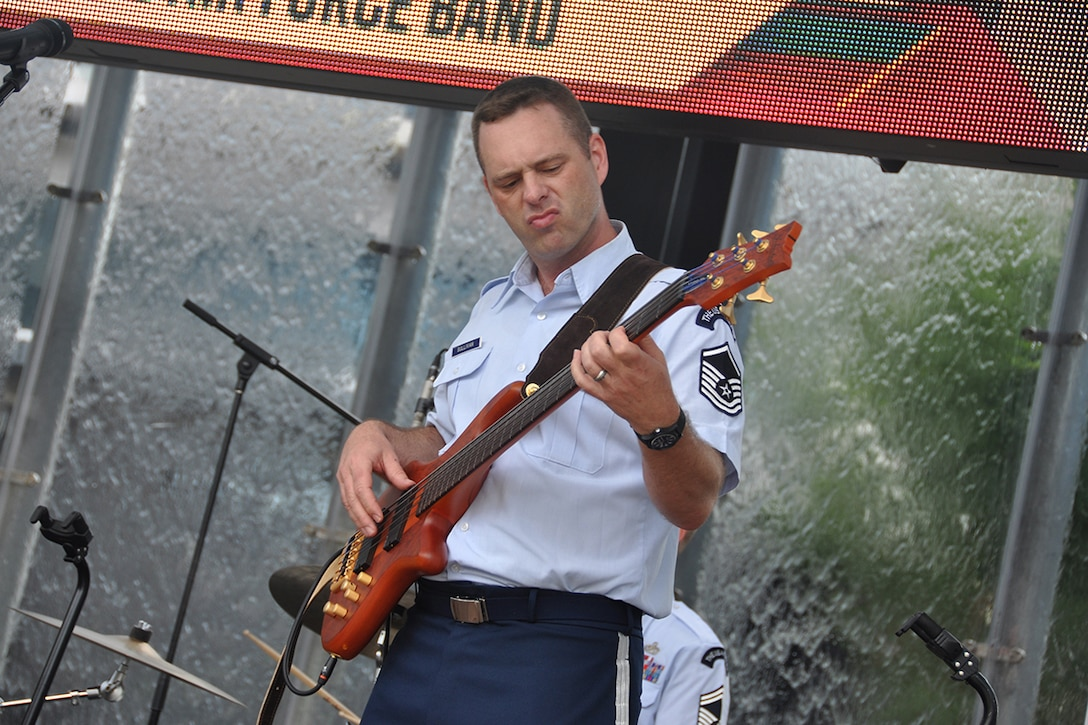 """Master Sgt. Eric Sullivan, Jr., U.S. Air Force Band's Celtic Aire vocalist and bassist, performs a pre-game concert at SunTrust Park in Atlanta, Georgia May 20, 2017. As part of the Atlanta Braves' Military Appreciation Day celebration, the band took the crowd on a folk and pop musical journey, opening with Paul Simon's """"Cecelia"""" and encoring with a medley of the armed forces' service songs. (U.S. Air Force photo/Master Sgt. James Branch)"""