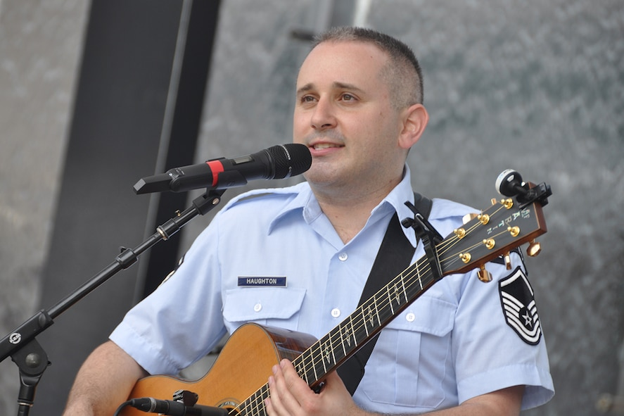 "Master Sgt. Joseph Haughton, U.S. Air Force Band's Celtic Aire vocalist and guitarist, performs during a pre-game concert at SunTrust Park in Atlanta, Georgia May 20, 2017. As part of the Atlanta Braves' Military Appreciation Day celebration, the band took the crowd on a folk and pop musical journey, opening with Paul Simon's ""Cecelia"" and encoring with a medley of the armed forces' service songs. (U.S. Air Force photo/Master Sgt. James Branch)"