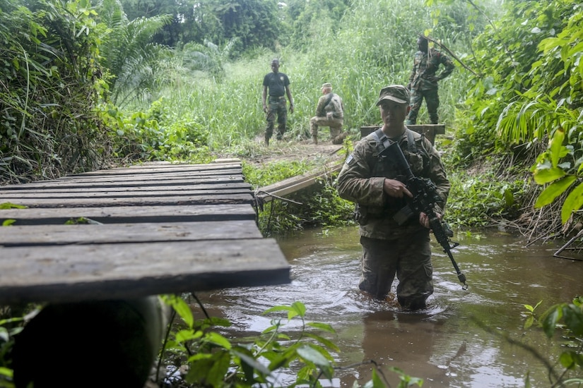 Army Spc. Jake Burley, assigned to the 1st Battalion, 506th Infantry Regiment, maneuvers through a river during United Accord 2017 at the Jungle Warfare School at Achiase military base in Akim Oda, Ghana, May 26, 2017. The school is designed to train participants in counter-insurgency and internal security operations. Army photo by Sgt. Brian Chaney