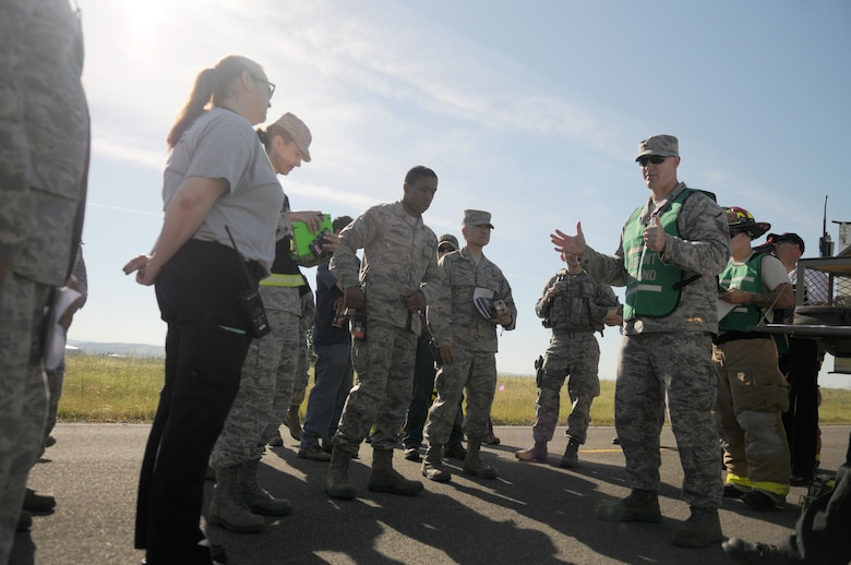 Airman assigned to Beale Air Force Base gather for a brief prior to a fuel spill exercise designed to see how well they respond at Beale AFB, California May 4, 2017. Exercises are designed and implemented by wing inspector generals, ensuring that Airmen are proficient in the skills needed for that scenario. (U.S. Air Force photo by Airman 1st Class Douglas Lorance)