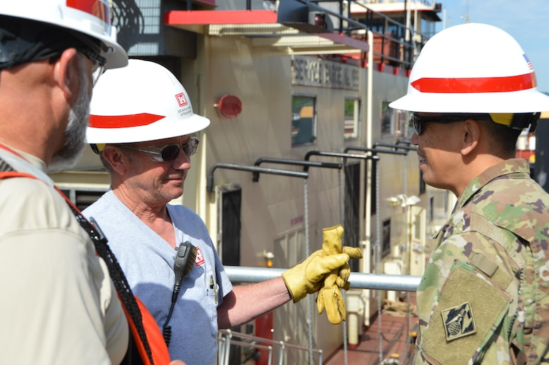 Recently BG Toy, Commanding General, Great Lakes and Ohio River Division, visited the Heavy Fleet of the Regional Rivers Repair Fleet (R3F) at Meldahl Locks and Dam. The Heavy Fleet is currently replacing Miter Gates and BG Toy was able to get a firsthand look at the work and spend some time with the crews of the fleet and the locks and dam.    BG Toy receives an update on the day's operations from Shift Supervisor Bill Adkins.