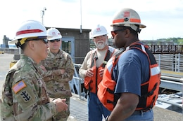 Recently BG Toy, Commanding General, Great Lakes and Ohio River Division, visited the Heavy Fleet of the Regional Rivers Repair Fleet (R3F) at Meldahl Locks and Dam. The Heavy Fleet is currently replacing Miter Gates and BG Toy was able to get a firsthand look at the work and spend some time with the crews of the fleet and the locks and dam.     BG Toy and COL Secrist speak with Fleet Superintendent Darrell Weaver and Welder Sam Lowery during recent visit to R3F.