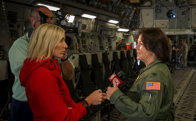 Syndey Ryan, a reporter from WCSC Live 5 News interviews Col. Jeanine McAnaney, 315th Airlift Wing vice commander, prior to a large formation training exercise over Carolina skies May 25. About 1,600 paratroopers from the 82nd Airborne Division packed 18 C-17 Globemaster IIIs from Joint Base Charleston, S.C. en-route to a Fort Bragg, N.C. airdrop. (U.S. Air Force Photo / Tech. Sgt. Bobby Pilch)