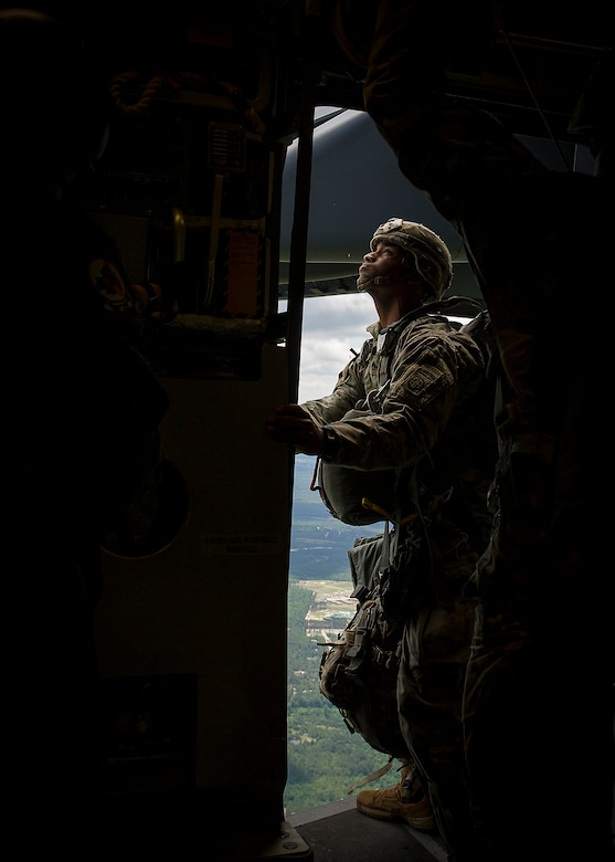 An 82nd Airbone Division jumpmaster checks outside a C-17 Globemaster III while en route to a Fort Bragg drop zone May 25.  Aircrews from the 315th and 437th Airlift Wings took off,  May 25, from Joint Base Charleston in 18 C-17 Globemaster IIIs within seconds of each other as part of a large formation exercise over Carolina skies. Exercise Bonny Jack was a joint service exercise with about 1,600 paratroopers from the 82nd Airborne Division at Fort Bragg.  (U.S. Air Force Photo / Master Sgt. Shane Ellis)