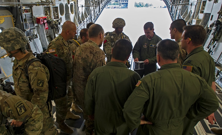 315th Operations Group Commander, Lt. Col. John Robinson give Army jumpmasters a pre-jump briefing before they take off for their drop zone at Fort Bragg, N.C. About 1,600 paratroopers from the 82nd Airborne Division packed 18 C-17 Globemaster IIIs from Joint Base Charleston, S.C. en-route to a a Fort Bragg, N.C. airdrop May 25. (U.S. Air Force Photo / Master Sgt, Shane Ellis)