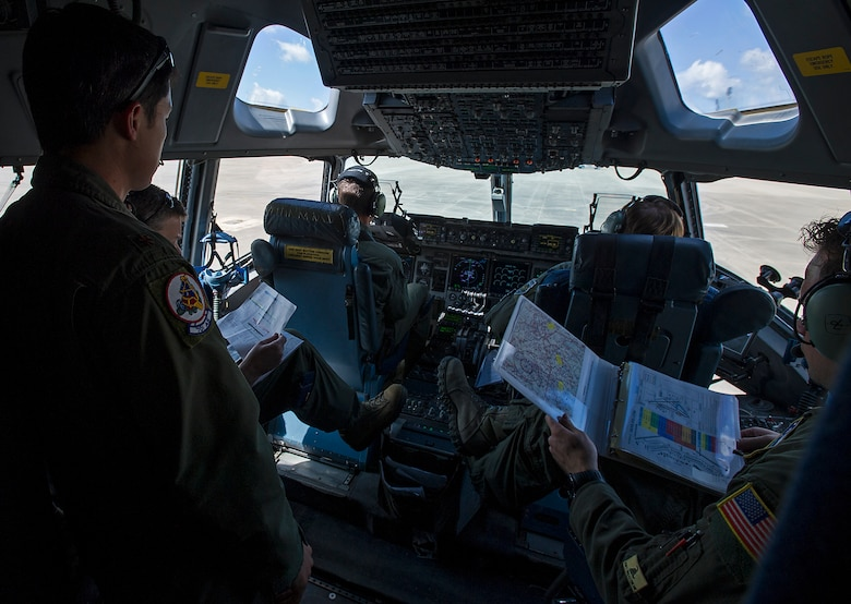 A 701st Airlift Squadron aircrew prepares to take off from Pope Army Airfield after parartroopers boarded their Charleston-based C-17 enroute to a drop zone at Fort Bragg, N.C. About 1,600 paratroopers from the 82nd Airborne Division packed 18 C-17 Globemaster IIIs from Joint Base Charleston, S.C. en-route to a a Fort Bragg, N.C. airdrop May 25. (U.S. Air Force Photo / Master Sgt, Shane Ellis)